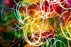 Abstract burred texture background of colorful bokeh motion. Long exposure of small neon lights