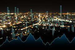 Abstract business bar graph on night city background.  Royalty Free Stock Image