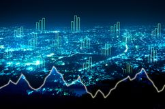 Abstract business bar graph on night city background.  Royalty Free Stock Photo