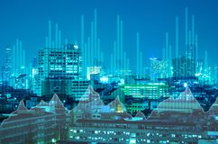 Abstract business bar graph on night city background.  Stock Photography