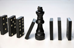 Abstract business concept with King chess piece and domino pieces fallen Stock Photography