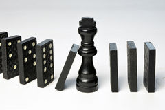 Abstract business concept with King chess piece and domino pieces fallen Stock Photo