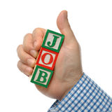 Abstract business man looking for a job. Man holding job word made of wooden toy blocks stock photography