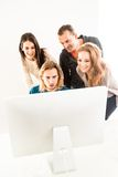 Abstract: Business team in office looking at Stock Photo
