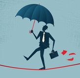 Abstract Businessman walks a precarious tightrope. Illustration of Retro styled Businessman walking carefully across a very high tightrope with his umbrella for Royalty Free Stock Photos