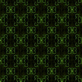 Abstract butterfly seamless pattern. Colored geometric figures on black background. Green Stock Photos