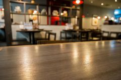 Abstract cafe coffee shoop restaurant blur background with bokeh. Abstract cafe coffee shoop restaurant interior blur background with bokeh light Stock Photography