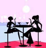 Girls in the cafe. In a abstract cafe are two girl friends Royalty Free Stock Images