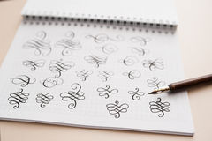 Abstract calligraphic figures hand drawing pointed stylus Royalty Free Stock Photography
