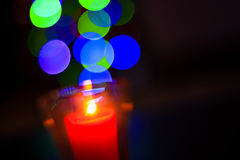 Abstract candle on bokeh. Royalty Free Stock Image