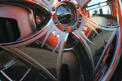 Abstract Cap. The chrome hubcap of a classic car has reflections that create an abstract design royalty free stock photos