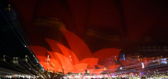 Abstract capture of the red colour illuminating the sails of the Opera House Royalty Free Stock Photography
