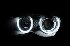 Abstract car circular front lights in darkness. Car circular headlights in darkness stock photo