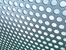 Abstract Carbon fibre perforated. Over light background Royalty Free Stock Photos