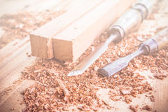 Abstract carpenter tools in pine wood table. Stock Image