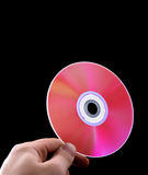 Abstract cd dvd blue-ray disk in hand Royalty Free Stock Photography