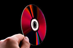 Abstract cd dvd blue-ray disk in hand Royalty Free Stock Images