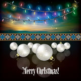 Abstract celebration background with Christmas decorations. Abstract celebration background with Christmas lights and white decorations on dark Royalty Free Stock Images