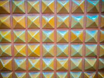 Abstract ceramic wall tiles in the shape of pyramid background. Royalty Free Stock Images