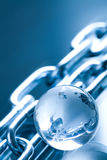 Abstract chain and globe Stock Images
