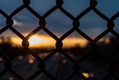 Abstract chain of link fence over highway. Royalty Free Stock Photography