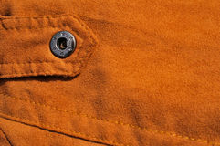 Abstract chamois background with seam and fastener Stock Image