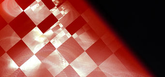 Abstract checkered background. Abstract background of white and orange checkered pattern on black background Royalty Free Stock Image
