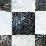 Abstract checkered pattern painted with acrylic or oil paints on canvas in black and white colors. Chessboard with a vintage texture for playing chess. Old Stock Photos