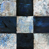 Abstract checkered pattern painted with acrylic or oil paints on canvas in black and white colors. Chessboard with a vintage texture for playing chess. Old Royalty Free Stock Images