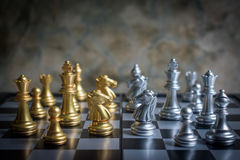 Abstract chess game face to face on a chessboard in lowkey tone Stock Images