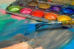 Abstract Child Art and watercolor palette. Abstract Child Art with watercolor palette and paintbrush stock photography