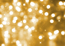 Abstract Christmas background. In gold tone Royalty Free Stock Photos