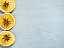 Abstract Christmas background with citrus fruit, slices of orange and star anise. Copy space Stock Images