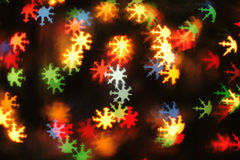 Abstract christmas background (color snowstars lights) Stock Image