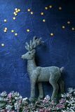 Abstract christmas background with deer. Christmas decoration deer on a blue background stock photos