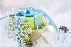 Abstract Christmas background with gift and balls close-up Stock Photos
