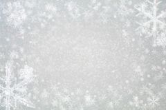 Abstract christmas background - glitter and snowflakes royalty free stock photography