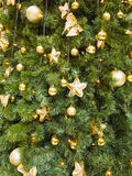 Abstract christmas background with golden balls and stars Stock Images