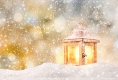 Abstract Christmas background with lantern. And falling snow flakes Stock Photos