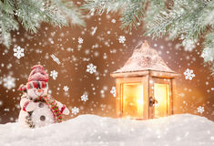 Abstract Christmas background with lantern. And falling snow flakes Royalty Free Stock Image