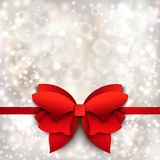 Abstract Christmas background with red bow. Paper cutout Royalty Free Stock Photos