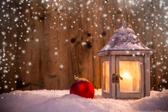 Abstract Christmas background with shining antern. Abstract Christmas background with shining lantern and falling snow flakes Royalty Free Stock Images