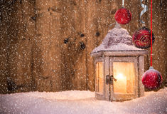 Abstract Christmas background with shining antern. Abstract Christmas background with shining lantern and falling snow flakes Royalty Free Stock Image