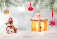 Abstract Christmas background with shining antern. Abstract Christmas background with shining lantern and falling snow flakes Stock Photo