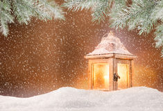 Abstract Christmas background with shining antern. Abstract Christmas background with shining lantern and falling snow flakes Royalty Free Stock Photography