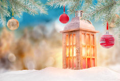 Abstract Christmas background with shining antern. Abstract Christmas background with shining lantern and falling snow flakes Stock Images