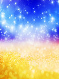 Abstract Christmas background with shiny stars. In blue and gold color. New year lights, starry sky Stock Photos