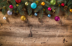 Abstract Christmas background. With spruce branches on old wooden table Stock Photos