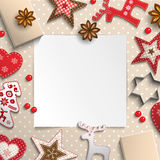 Abstract christmas background, white sheet of paper lying among small scandinavian styled decorations on polka dot beige Royalty Free Stock Photo