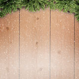 Abstract christmas backgrounds. With xmas decorations over old wooden desk Royalty Free Stock Photo